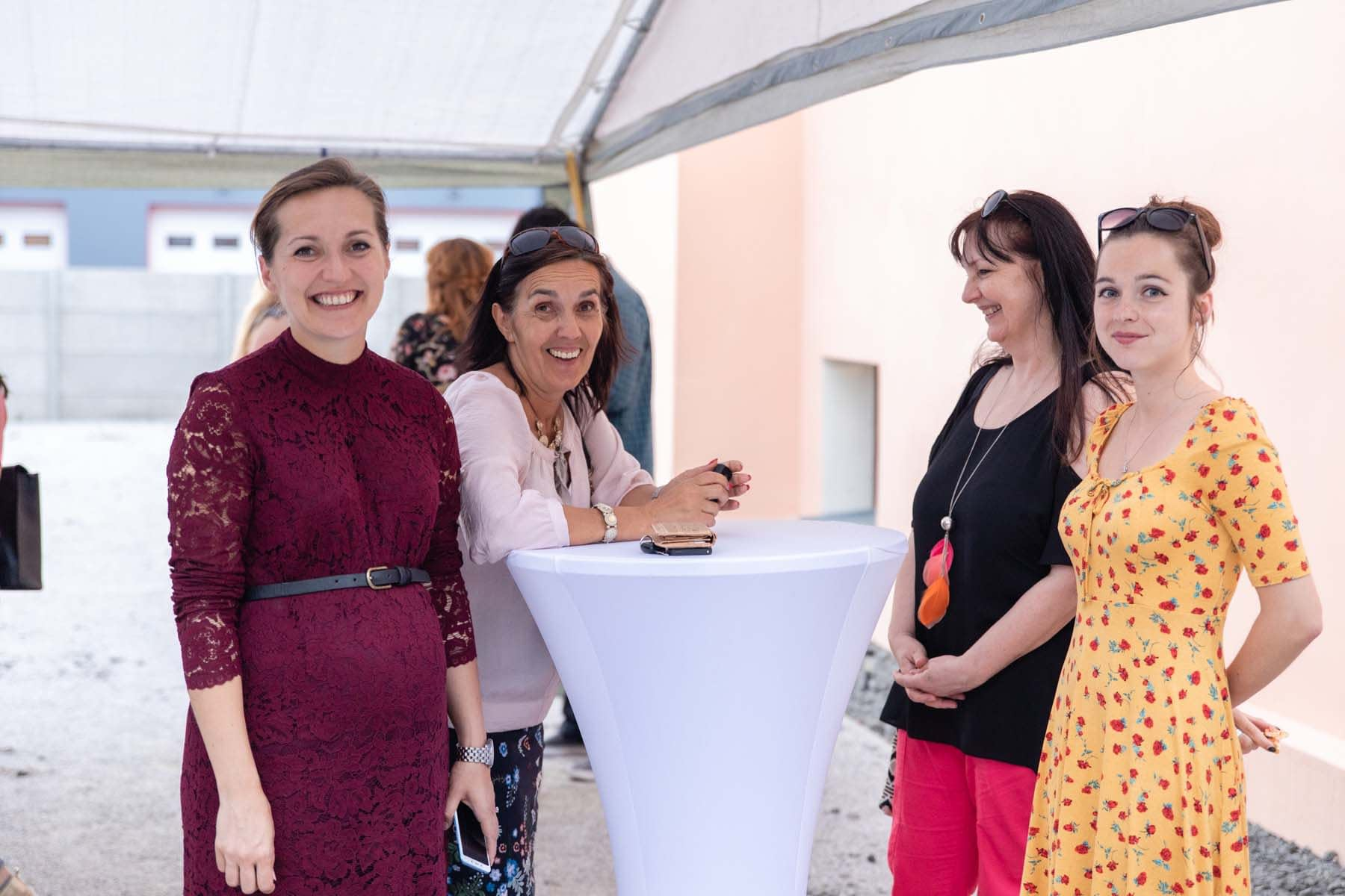Ms. Anna Humbert (left) with guests of the event