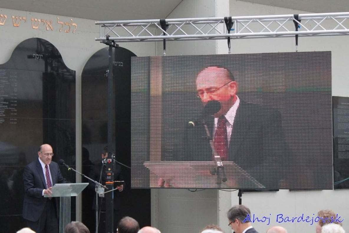 Mr. Emil A. Fish speaks at the Dedication Ceremony