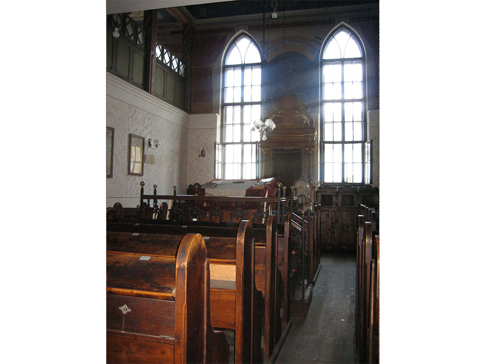 Interior with the preserved wooden praying benches