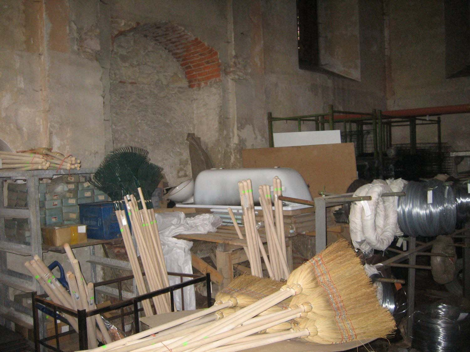 Bardejov Old Synagogue interior Eastern wall showing various building supplies occupying the space before restoration