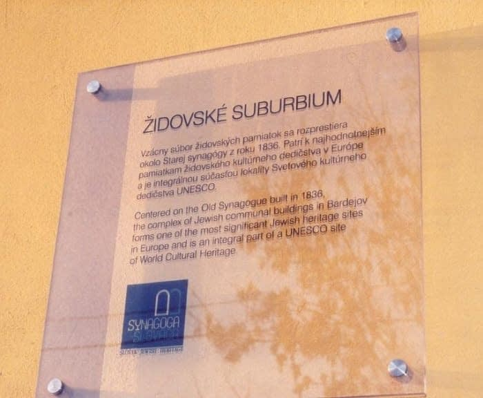 Plaque on the Mikvah Exterior Wall
