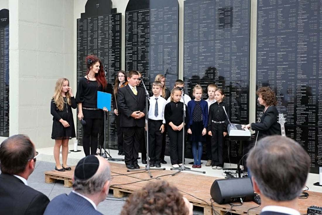 Local Children Choir sing in Hebrew 'Every Person has a Name', by Zelda Schneersohn Mishkovsky at the Dedication Ceremony