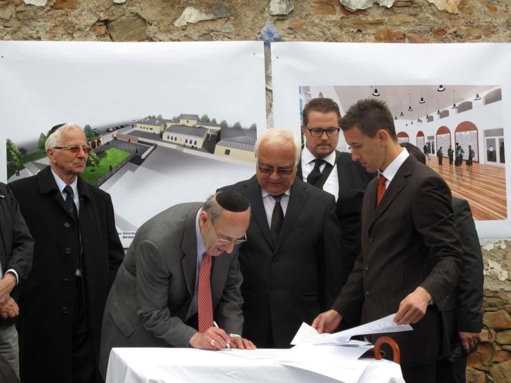 Bardejov Mayor Mr. Boris Hanuscak, and Mr. Fish, signing the agreement to build the Bardejov Holocaust Memorial during the May 2012 gathering in Bardejov