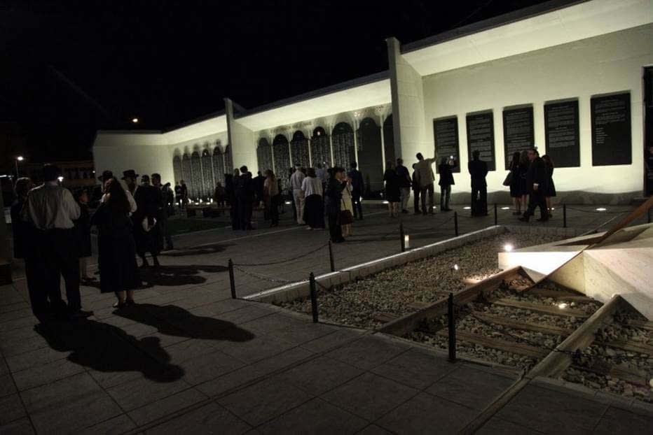 Participants gather at the Memorial on the evening of the Dedication Ceremony