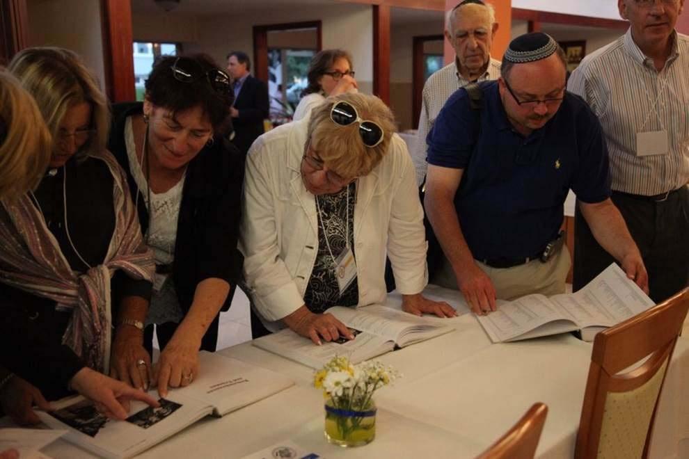 Participants view the Memorial Book of Jewish Bardejov