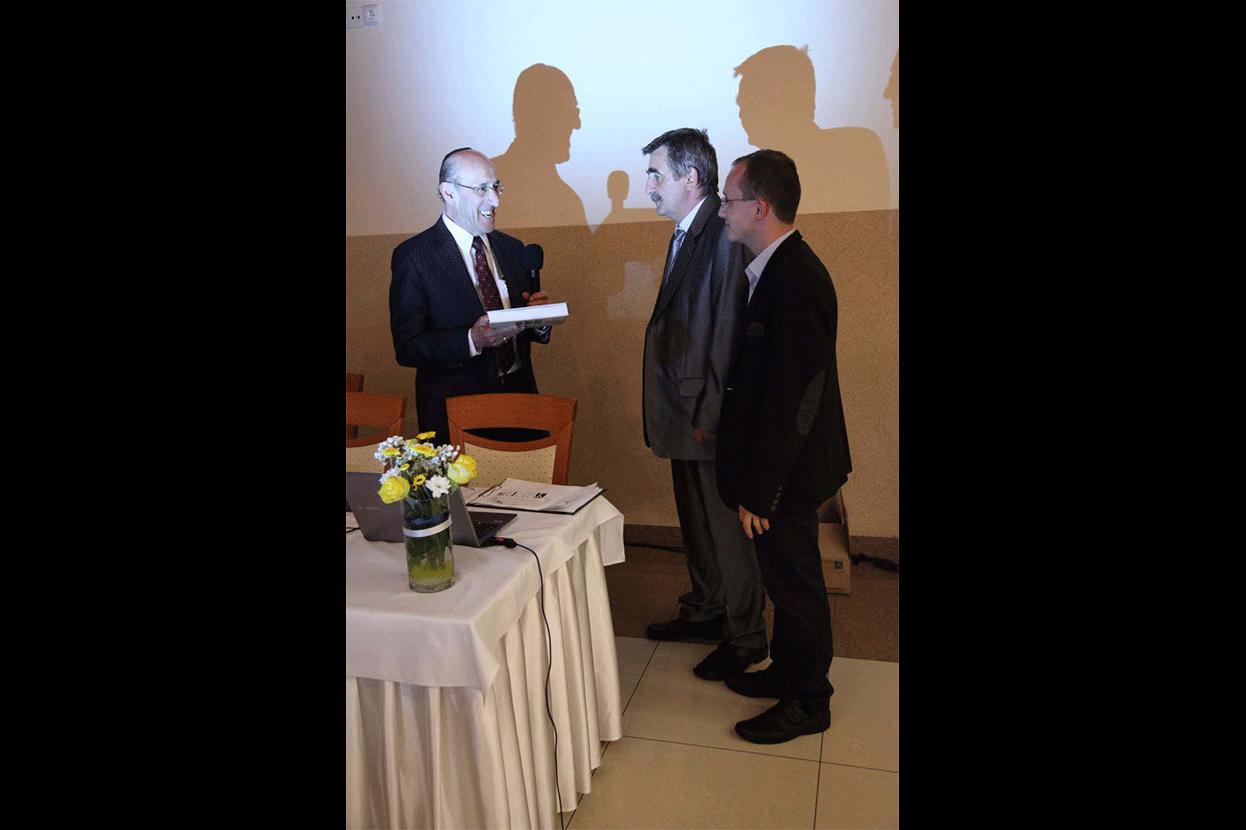 Mr. Fish presents the Memorial Book to Peter Hudak and Pavol Hudak