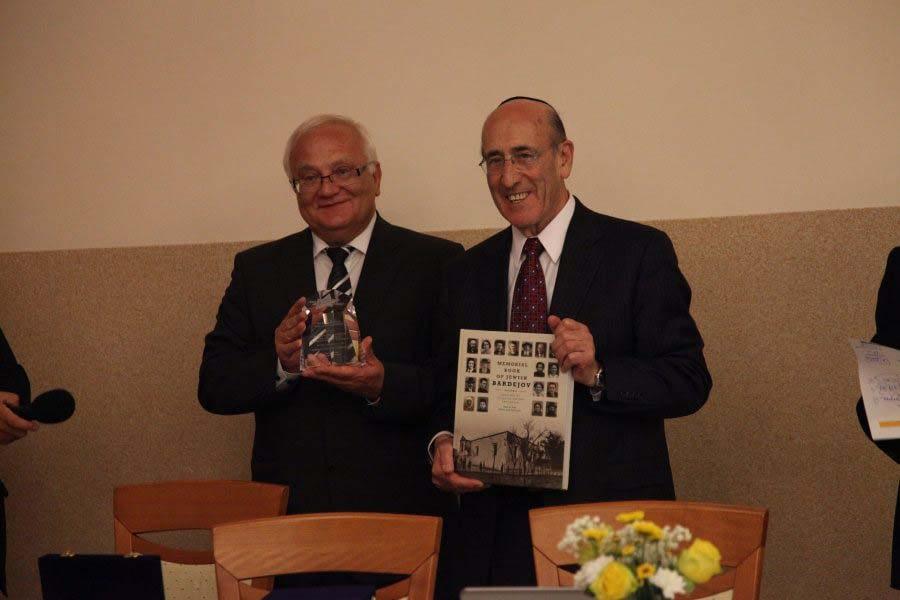 Mr. Hanuscak, Mayor of Bardejov, receives his award and the Memorial Book of Jewish Bardejov