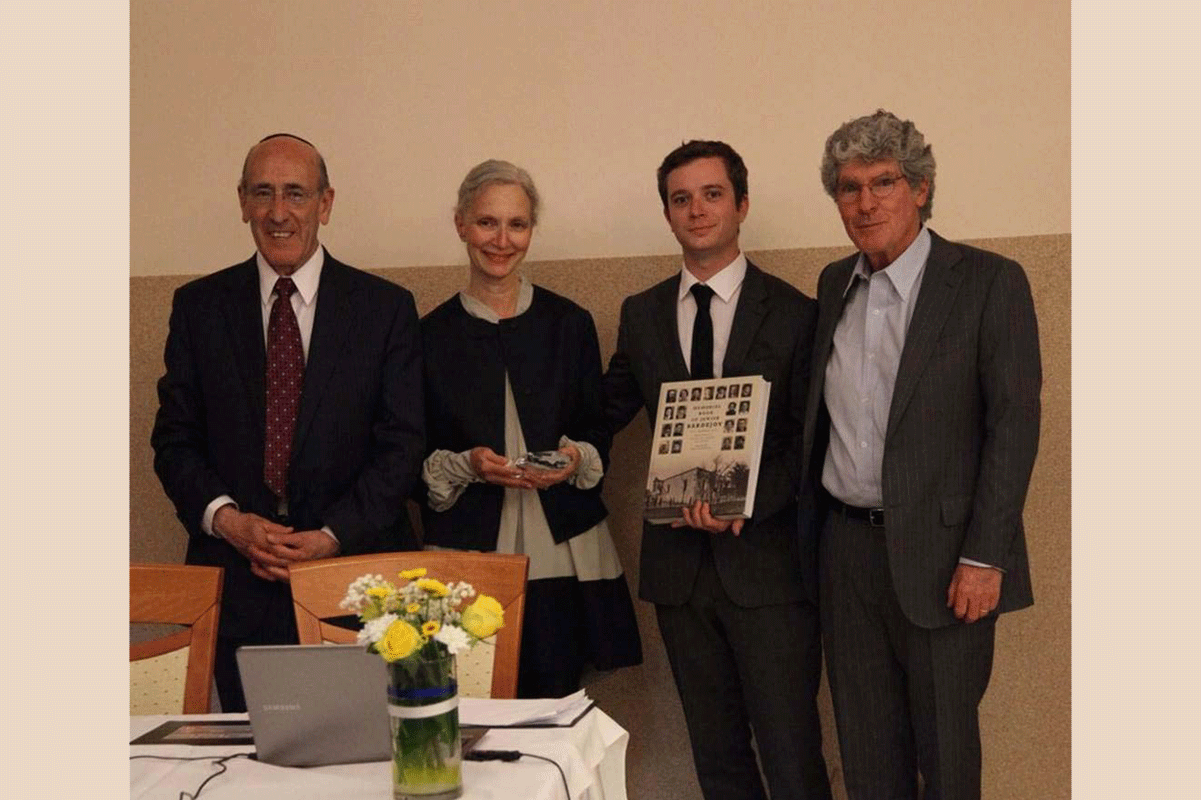 The Friedman family receive their award and Memorial Book