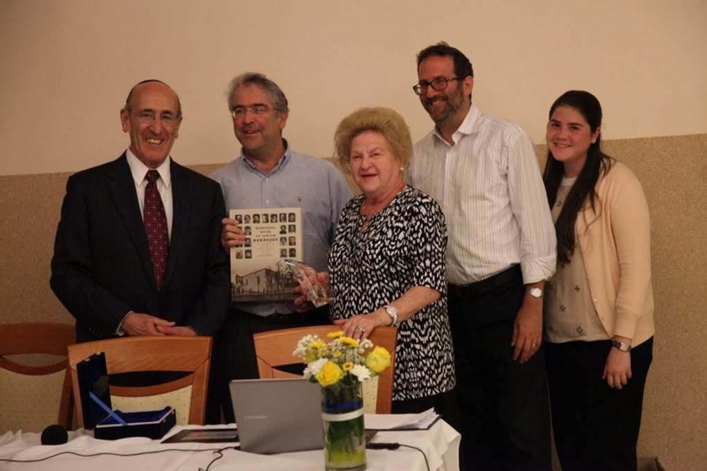 The Rosenbaum family receive their award and Memorial Book