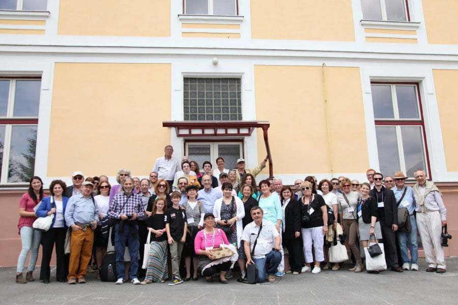 Participants gather for a group photo on the steps of the local school where many group pictures of 'Bardejovers' were taken in the past