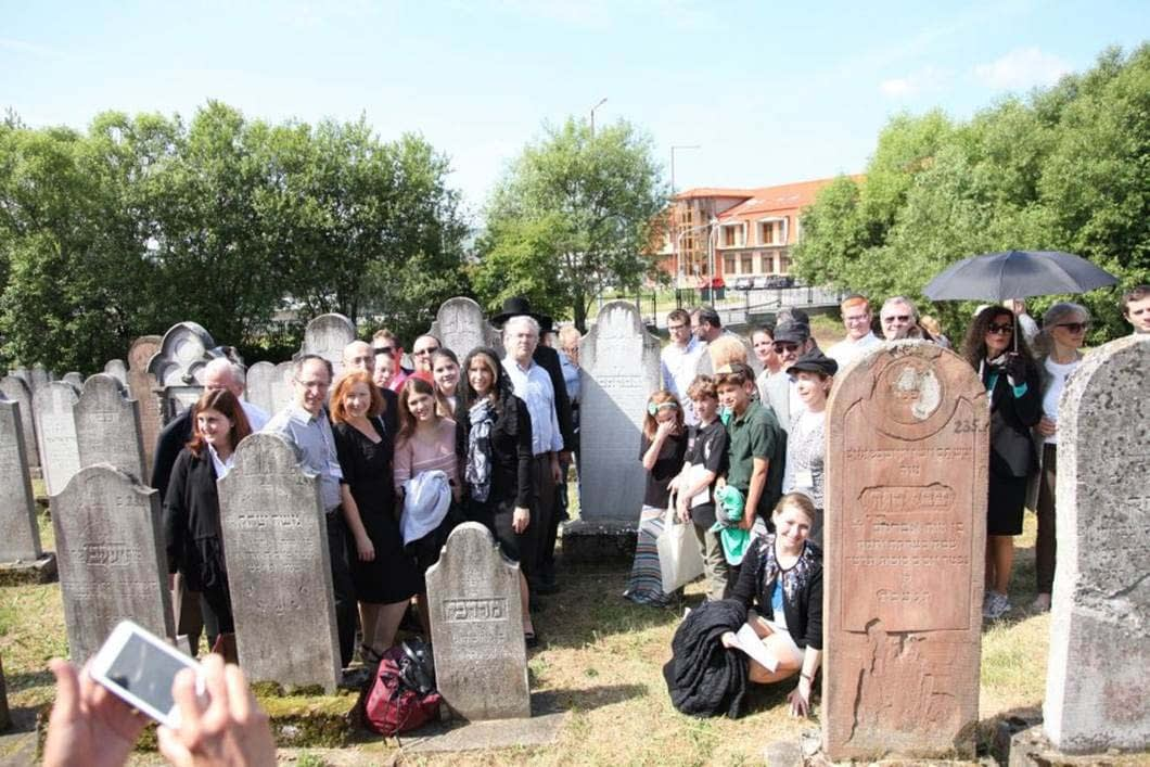 Participants visit the Bardejov Jewish Cemetery on the day of the Dedication