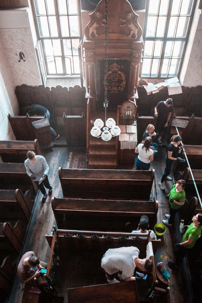 The students split up to tackle cleaning different areas of the synagogue at the same time