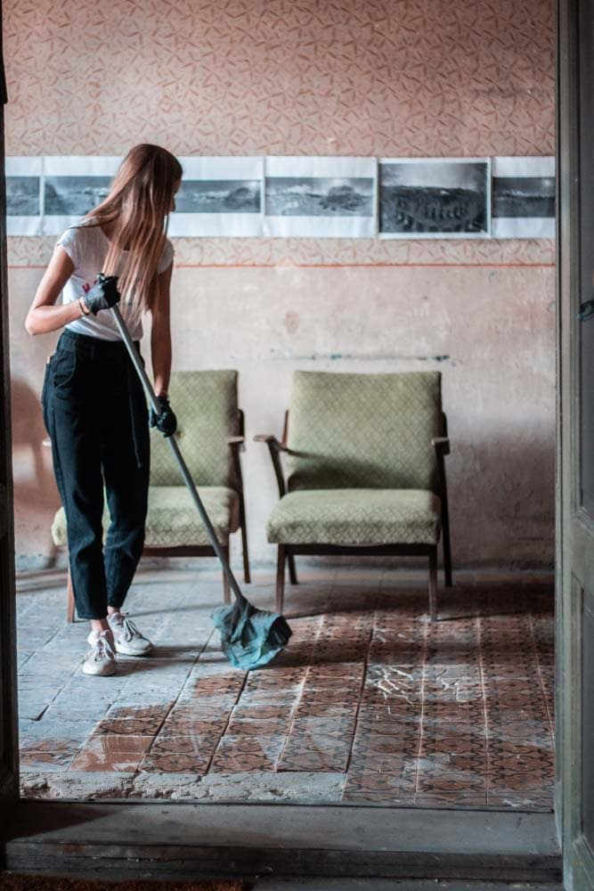 Students brought mops and brooms to get the job done